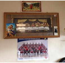 Christianity and football photos on cafe wall