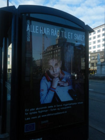 Poster showing campaign to help Syrian refugees