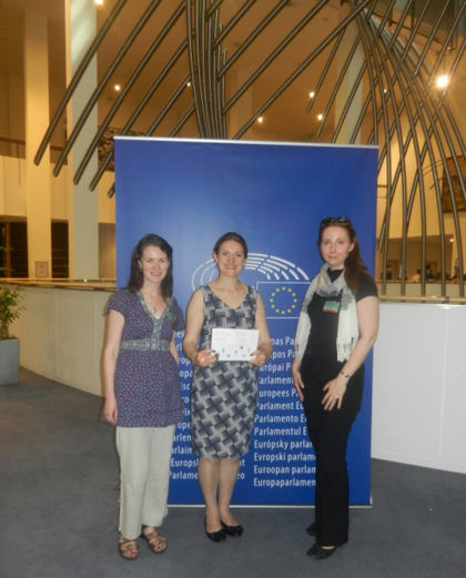 Catherine Stihler, an MEP for Scotland, holding the DIMECCE booklet (with Dr Fiona McCallum and Dr Marta Wozniak)